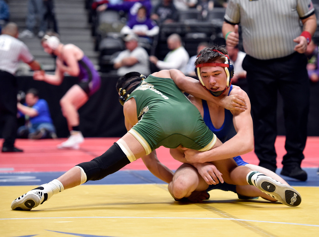. DENVER, CO - FEBRUARY 21, 2019: Lyons High School\'s David Gardner wrestles Highland\'s Hector Flores during a 2A 145-pound match during the first day of the CHSAA State Wrestling Championships on Thursday at the Pepsi Center in Denver. Gardner lost the match. More photos: BoCoPreps.com (Photo by Jeremy Papasso/Staff Photographer)