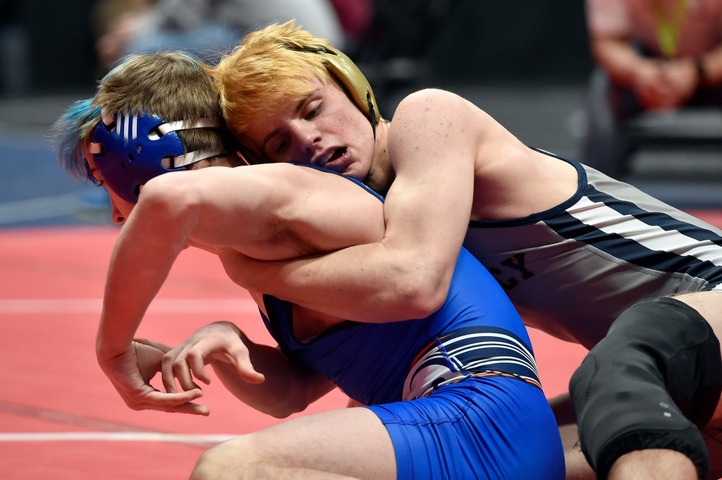 . DENVER, CO - FEBRUARY 21, 2019: Legacy High School\'s Kevin Luker wrestles Legend\'s Kade Syddall during a  5A 138-pound match during the first day of the CHSAA State Wrestling Championships on Thursday at the Pepsi Center in Denver. More photos: BoCoPreps.com (Photo by Jeremy Papasso/Staff Photographer)