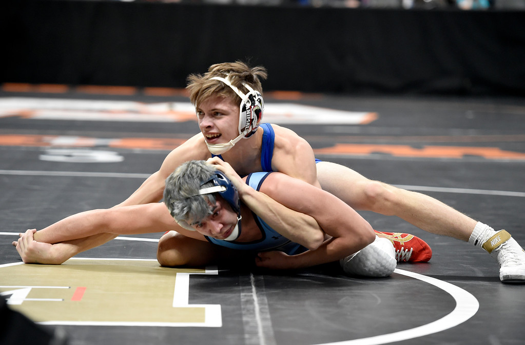 . DENVER, CO - FEBRUARY 21, 2019: Lyons High School\'s Christian Keller wrestles Trinidad\'s Guerillmo Felthager during a 2A 120-pound match during the first day of the CHSAA State Wrestling Championships on Thursday at the Pepsi Center in Denver. Keller won the match. More photos: BoCoPreps.com (Photo by Jeremy Papasso/Staff Photographer)