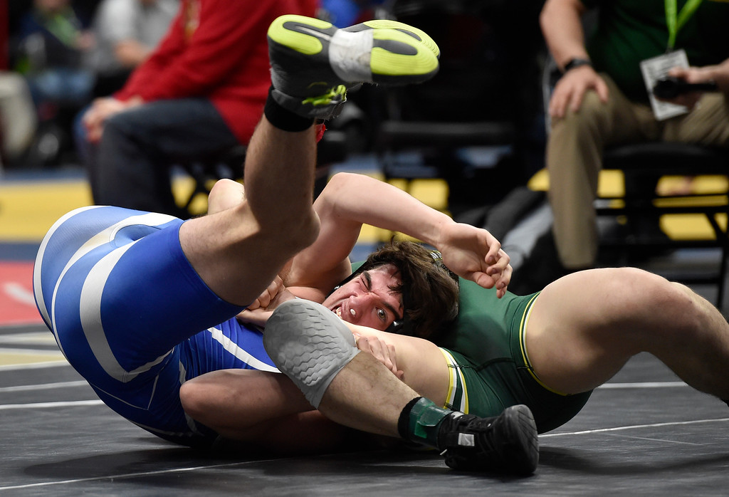 . DENVER, CO - FEBRUARY 21, 2019: Longmont High School\'s Audie Herrera tries to avoid being pinned by Pueblo County\'s Christopher Fasano during a  4A 160-pound match during the first day of the CHSAA State Wrestling Championships on Thursday at the Pepsi Center in Denver. Herrera lost the match. More photos: BoCoPreps.com (Photo by Jeremy Papasso/Staff Photographer)