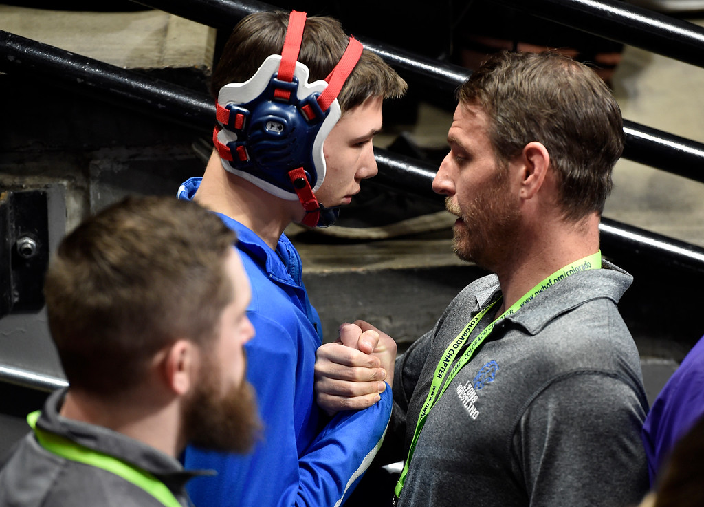 . DENVER, CO - FEBRUARY 21, 2019: Lyons High School assistant coach Gary Gantzer gives a pre-match pep talk to David Gardner before his 2A 145-pound match during the first day of the CHSAA State Wrestling Championships on Thursday at the Pepsi Center in Denver. More photos: BoCoPreps.com (Photo by Jeremy Papasso/Staff Photographer)