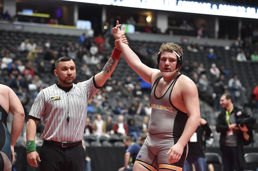 . DENVER, CO - FEBRUARY 21, 2019: Monarch High School\'s Will Ponder has his arm raised after defeating Westminster\'s Thomas Cherrington during a 5A 220-pound match during the first day of the CHSAA State Wrestling Championships on Thursday at the Pepsi Center in Denver. Ponder won the match. More photos: BoCoPreps.com (Photo by Jeremy Papasso/Staff Photographer)