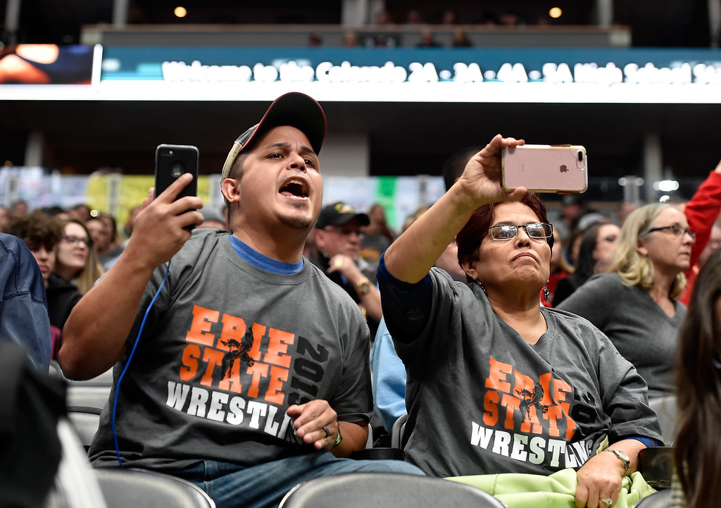 . DENVER, CO - FEBRUARY 21, 2019: Oscar Fonseca, left,  his mother Bertha Contreras cheer for Erie High School\'s Gus Fonseca-Walker during a  4A 126-pound match during the first day of the CHSAA State Wrestling Championships on Thursday at the Pepsi Center in Denver. More photos: BoCoPreps.com (Photo by Jeremy Papasso/Staff Photographer)