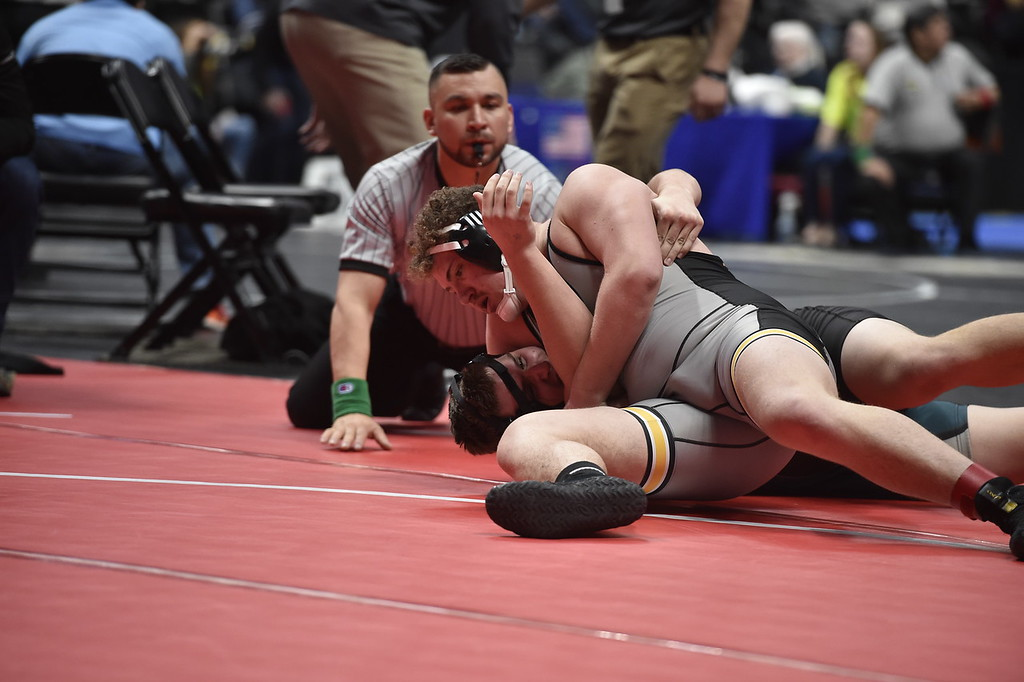 . DENVER, CO - FEBRUARY 21, 2019: Monarch High School\'s Will Ponder works to pin Westminster\'s Thomas Cherrington during a 5A 220-pound match during the first day of the CHSAA State Wrestling Championships on Thursday at the Pepsi Center in Denver. Ponder won the match. More photos: BoCoPreps.com (Photo by Jeremy Papasso/Staff Photographer)