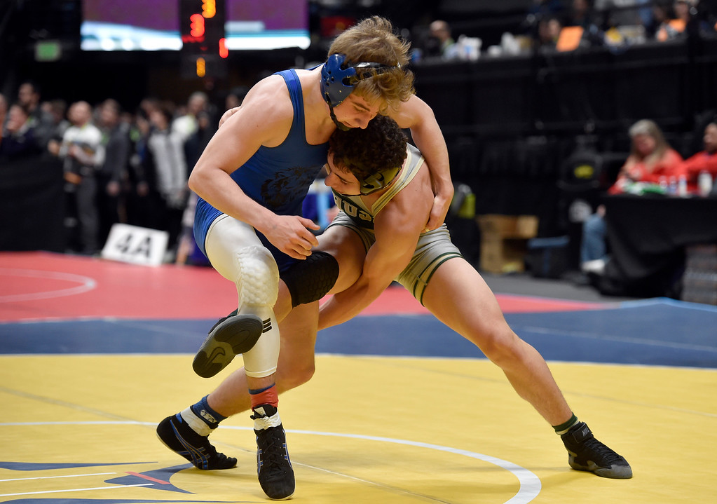 . DENVER, CO - FEBRUARY 22, 2019: Lyons High School\'s Oran Huff wrestles Highland\'s Zach Tittle during a 2A 126-pound semifinal match on the second day of the CHSAA State Wrestling Championships on Friday at the Pepsi Center in Denver. More photos: BoCoPreps.com (Photo by Jeremy Papasso/Staff Photographer)