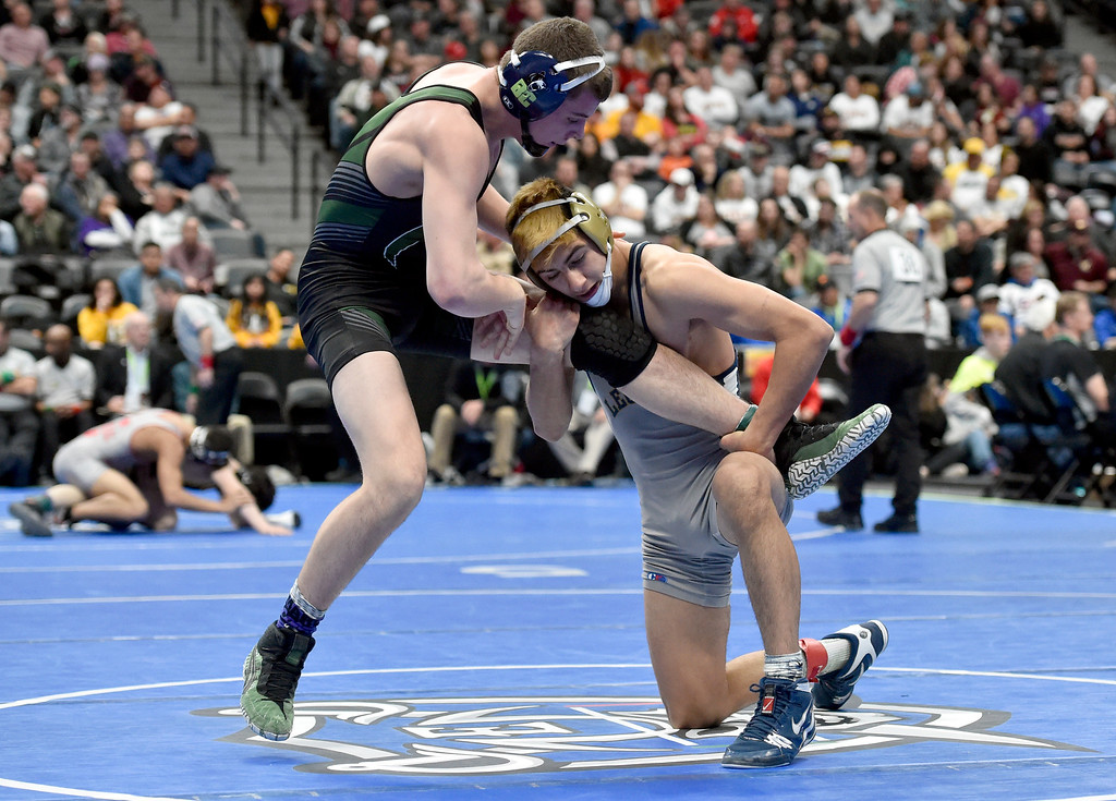 . DENVER, CO - FEBRUARY 22, 2019: Legacy High School\'s Joey Joiner wrestles Fossil Ridge\'s Cody Ginther during a 5A 145-pound semifinal match on the second day of the CHSAA State Wrestling Championships on Friday at the Pepsi Center in Denver. Joiner won the match. More photos: BoCoPreps.com (Photo by Jeremy Papasso/Staff Photographer)