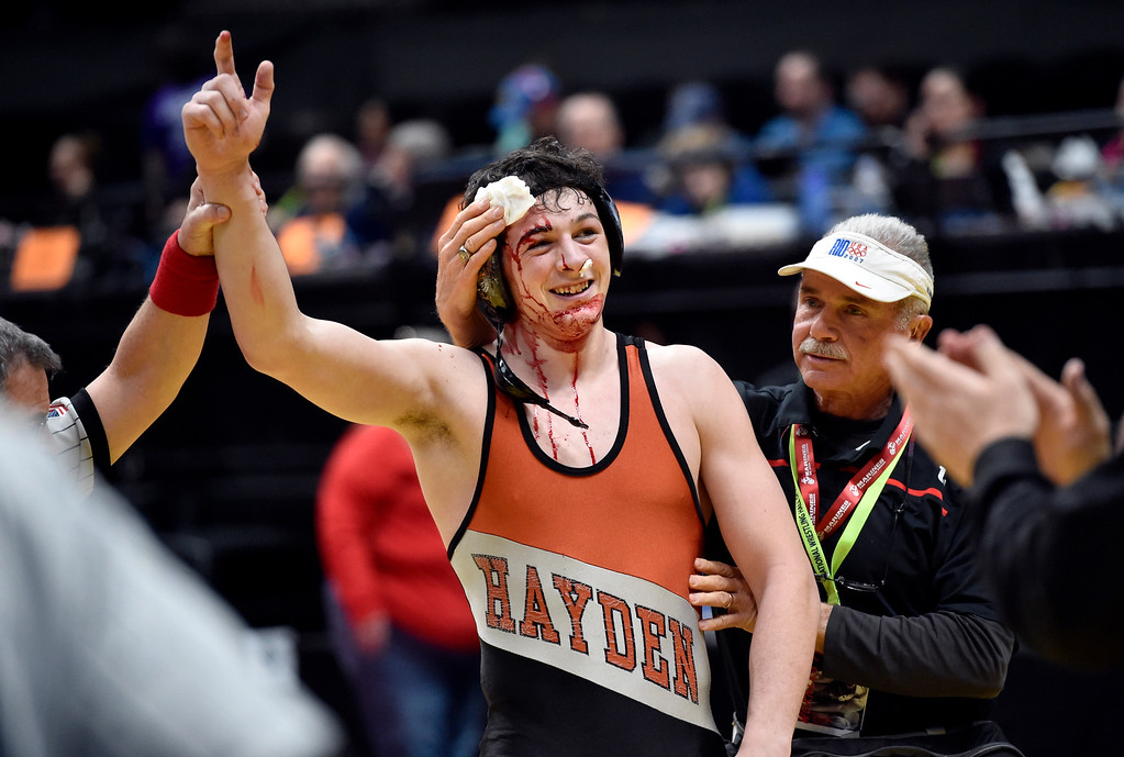 . DENVER, CO - FEBRUARY 22, 2019: Hayden High School\'s Hunter Planansky smiles with a bloody head after  winning a 2A 182-pound semifinal match on the second day of the CHSAA State Wrestling Championships on Friday at the Pepsi Center in Denver. More photos: BoCoPreps.com (Photo by Jeremy Papasso/Staff Photographer)
