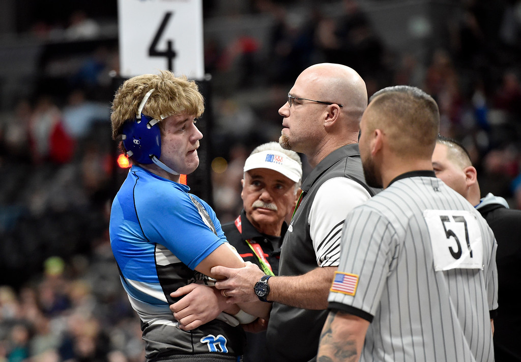 . DENVER, CO - FEBRUARY 22, 2019: Broomfield High School\'s Bryant Walker talks with Head Coach Pat Decamillis about an injury to his arm while wrestling Cheyenne Mountain\'s Nico Gagliardi during a 4A 195-pound semifinal match on the second day of the CHSAA State Wrestling Championships on Friday at the Pepsi Center in Denver. More photos: BoCoPreps.com (Photo by Jeremy Papasso/Staff Photographer)