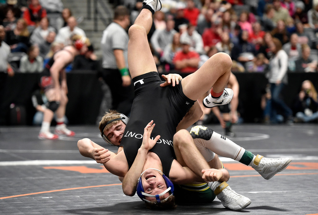 . DENVER, CO - FEBRUARY 22, 2019: Longmont High School\'s Brayden Engelking gets flipped by Pueblo County\'s Trevor Singleton during a 4A 152-pound semifinal match on the second day of the CHSAA State Wrestling Championships on Friday at the Pepsi Center in Denver. Engelking lost the match. More photos: BoCoPreps.com (Photo by Jeremy Papasso/Staff Photographer)