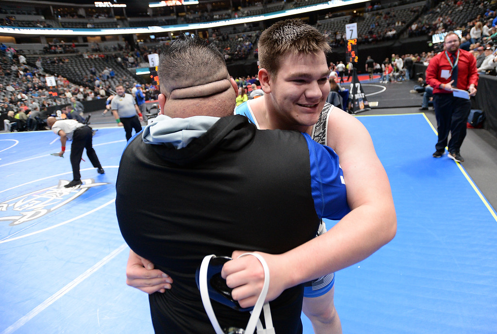 . DENVER, CO - FEBRUARY 22, 2019: Broomfield High School\'s Tyler Carpenter hugs assistant coach Myke Rivera after defeating Denver North\'s Max Tafoya during a 4A 285-pound semifinal match on the second day of the CHSAA State Wrestling Championships on Friday at the Pepsi Center in Denver. More photos: BoCoPreps.com (Photo by Jeremy Papasso/Staff Photographer)