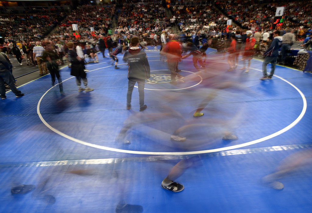 . DENVER, CO - FEBRUARY 22, 2019: Semifinal wrestlers warm up on the mat on the second day of the CHSAA State Wrestling Championships on Friday at the Pepsi Center in Denver. More photos: BoCoPreps.com (Photo by Jeremy Papasso/Staff Photographer)