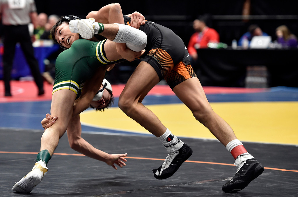 . DENVER, CO - FEBRUARY 22, 2019: Erie High School\'s Rudy Lopez wrestles Pueblo County\'s Brendon Garcia during a 4A 113-pound semifinal match on the second day of the CHSAA State Wrestling Championships on Friday at the Pepsi Center in Denver. Lopez lost the match. More photos: BoCoPreps.com (Photo by Jeremy Papasso/Staff Photographer)