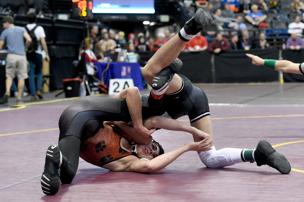 . Holly High School\'s Cody Crum tries to avoid a pin during a class 2A 113-pound wrestling match against Dante Chiricingo, of Highlands High School, during the first day of the CHSAA State Wrestling Championships on Thursday at the Pepsi Center in Denver. More photos: www.BoCoPreps.com Jeremy Papasso/ Staff Photographer/ Feb. 16, 2017
