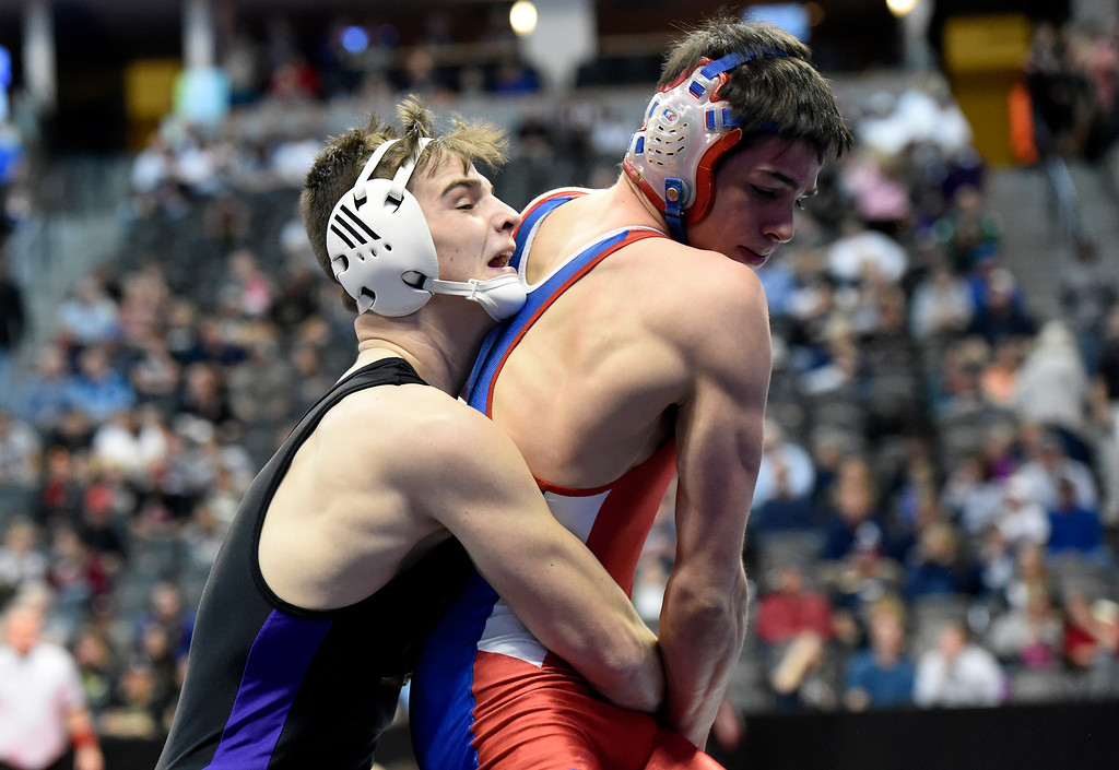 . Holy Family High School\'s Kolsen Welham looks for a takedown during a class 3A 160-pound wrestling match against Buena Vista\'s Denver Hargrove during the first day of the CHSAA State Wrestling Championships on Thursday at the Pepsi Center in Denver. More photos: www.BoCoPreps.com Jeremy Papasso/ Staff Photographer/ Feb. 16, 2017