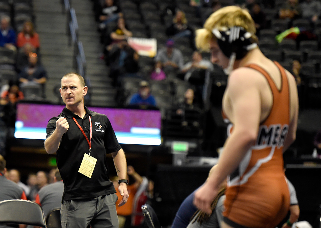 . Mead High School coach Jonathan Nichols shows his excitement after Jeremy Ashton defeated Wheat Ridge\'s Angelo Vecchiarelli during a class 5A 132-pound wrestling match during the first day of the CHSAA State Wrestling Championships on Thursday at the Pepsi Center in Denver. More photos: www.BoCoPreps.com Jeremy Papasso/ Staff Photographer/ Feb. 16, 2017