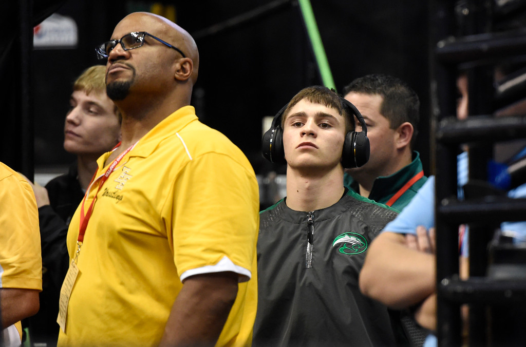 . Niwot High School\'s Tommy Stager listens to music before wrestling Valor Christian\'s Payton Polson during a class 5A 145-pound wrestling match during the first day of the CHSAA State Wrestling Championships on Thursday at the Pepsi Center in Denver. More photos: www.BoCoPreps.com Jeremy Papasso/ Staff Photographer/ Feb. 16, 2017
