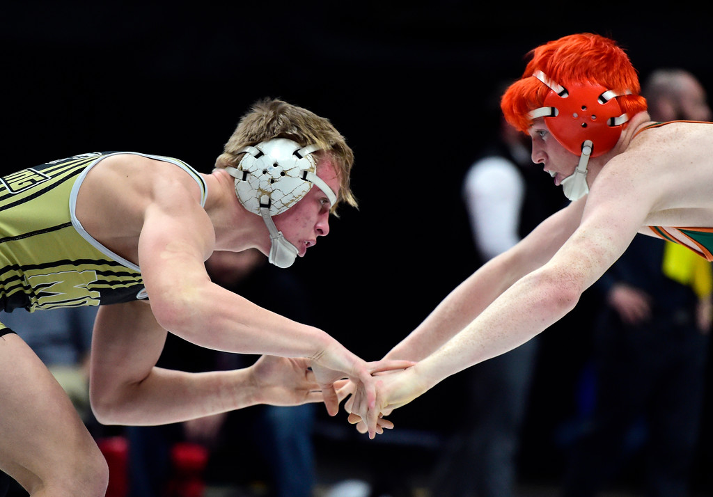 . Monarch High School\'s Parker McQuade, left, wrestles Gavin Deaguero, of Adams City, during a 5A 152-pound semi-final match during day 2 of the CHSAA State Wrestling Tournament  on Friday at the Pepsi Center in Denver. More photos: BoCoPreps.com Jeremy Papasso/ Staff Photographer 02/16/2018