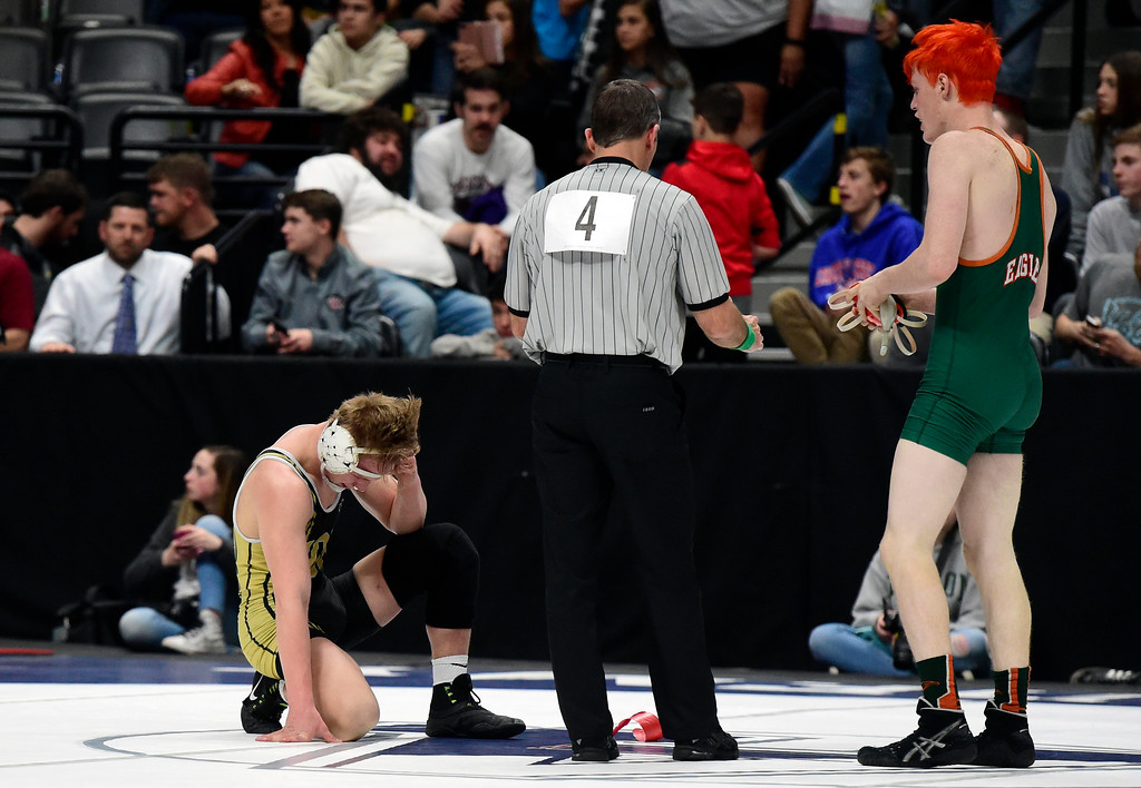 . Monarch High School\'s Parker McQuade reacts after losing to Gavin Deaguero, of Adams City, during a 5A 152-pound semi-final match during day 2 of the CHSAA State Wrestling Tournament  on Friday at the Pepsi Center in Denver. More photos: BoCoPreps.com Jeremy Papasso/ Staff Photographer 02/16/2018
