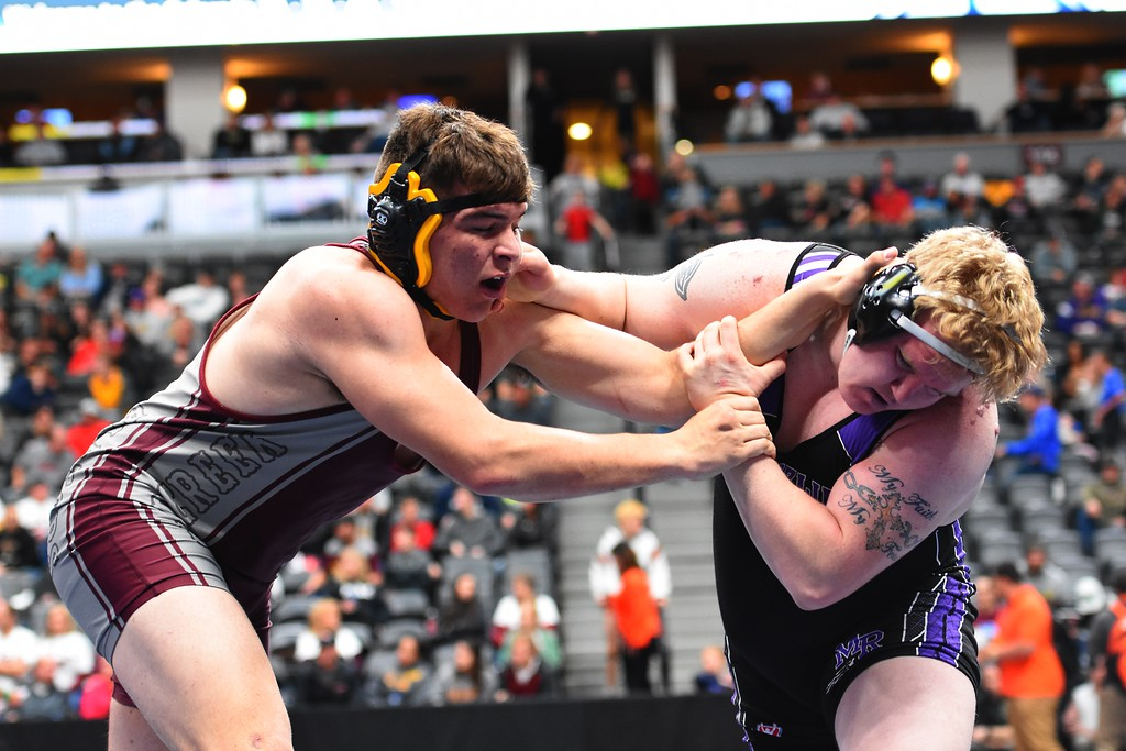. Silver Creek High School\'s Jacob Williams wrestles Michael True, of Mesa Ridge, during a 4A 285-pound match during day 2 of the CHSAA State Wrestling Tournament  on Friday at the Pepsi Center in Denver. More photos: BoCoPreps.com Brad Cochi 02/16/2018