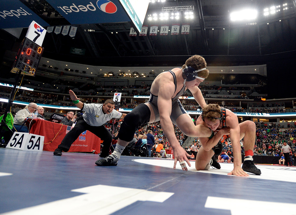 . Legacy High School\'s Aidan Funk tries to escape the grasp of Grand Junction\'s Jay Skalecki during a 5A 170-pound semi-final match during day 2 of the CHSAA State Wrestling Tournament  on Friday at the Pepsi Center in Denver. Funk won the match. More photos: BoCoPreps.com Jeremy Papasso/ Staff Photographer 02/16/2018