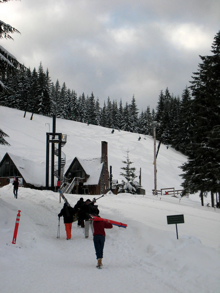 Carrying gear to the Ski Bowl East lodge