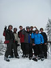 Rob, Isabel, Ryan, Davis, Paul, Quentin, and Makai give a big Peace Out on West Peak