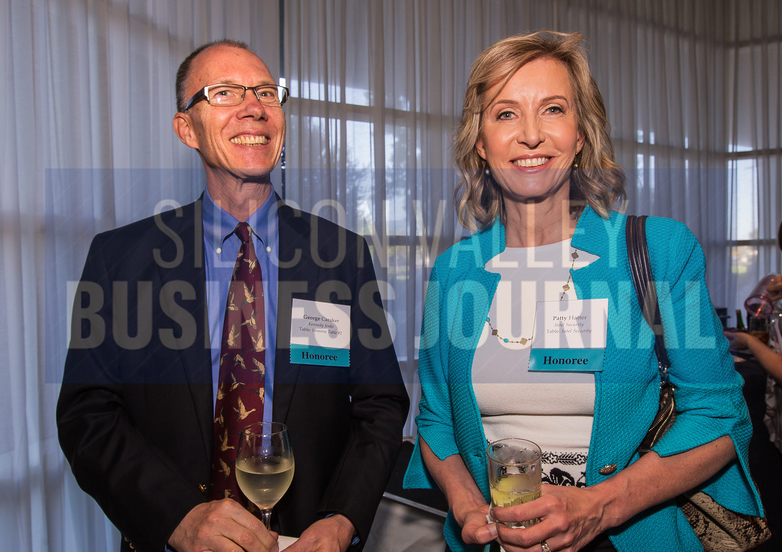 (L2R) Honoree's George Caraker from Kennedy Jenks and Patty Hatter from Intel Security.
