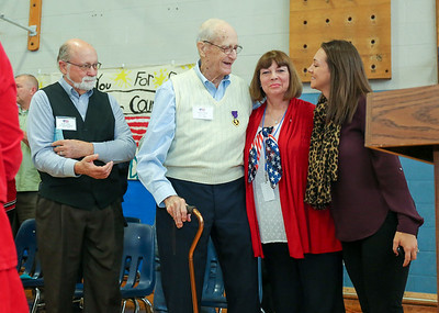 World War II veteran Clifton Caldon with Brian Caldon, left, Janet Kochanowski and Karaugh Prugar.  Photo by John Fitts