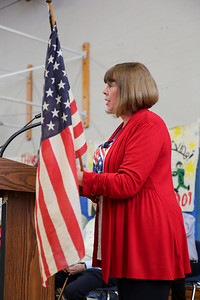 "Janet Kochanowski reads ""That Ragged Old Flag"" during Canton Intermediate School's during a celebration of service to our country ceremony on Veterans Day 2016.  Photo by John Fitts"