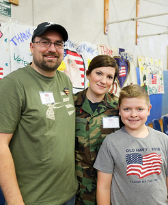 Tom (U.S. Army 2007-2010) and Leslie DuBois (U.S. Air Force (1999-2002) with Ryder Dean.  Photo by John Fitts