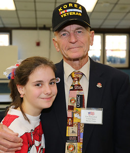 Tom Butterfield, United States Marine Corps veteran with granddaughter Alice.  Photo by John Fitts