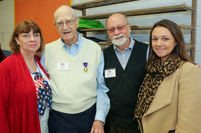 Clifton Caldon, a World War II veteran who served from 1943 to 1945 with his family. From left are Janet Kochanowski, U.S. Army veteran Clifton Caldon, CT National Guard veteran and Karaugh Prugar, who is Clifton's granddaughter.  Photo by John Fitts