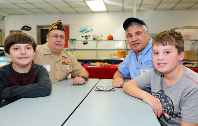Clockwise from left are Tyler Zommer, his grandfather Richard Zommer ( U.S. Marine Corps 1966-1970), Samuel Saverine (U.S. Navy 1966-1970) and Chase Ahlgren. Photo by John Fitts