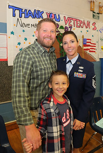 Dan Robison (U.S. Air Force 1988-2014) and Amy Robison (CT Air National Guard) with son Daniel. Missing from photo is daughter Sophia. Photo by John Fitts
