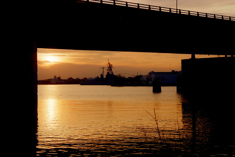 "THE DISPLAY SHIP ""BARRY"", VIEWED FROM UNDER A BRIDGE AT SUN SET, ACCROSS THE ANACOSTIA RIVER."