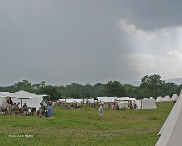 A wall of rain approaches the Confederate camp.