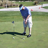 cji08_010_goetzke_warms_up_on_thistle_putting_green_030608