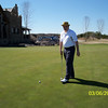 cji08_014_nagy_seems_mildly_happy_with_putter_030608