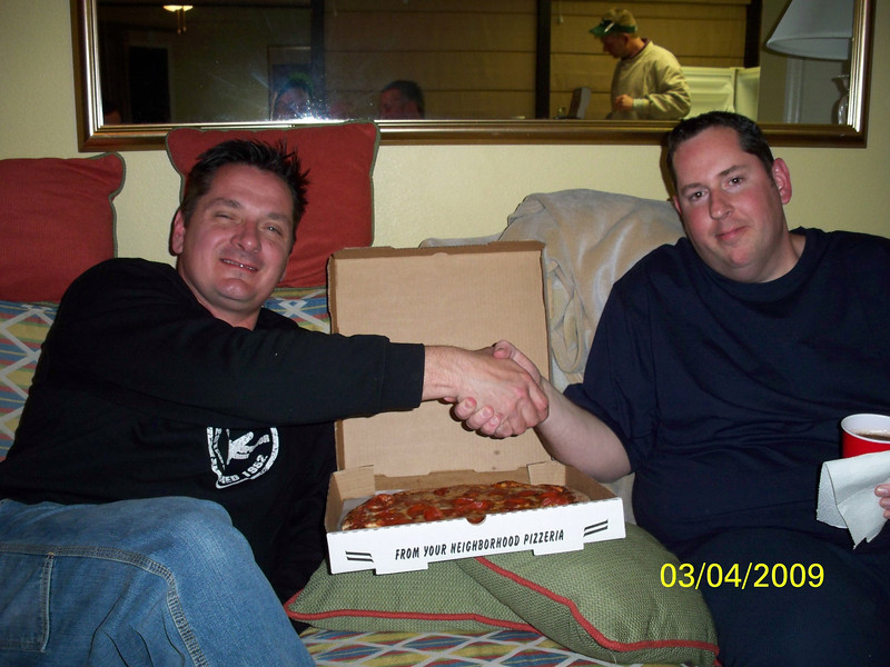 09cji_nagy_camera_030409_11_captains_nagy_mckay_shake_hands_and_eat_pizza