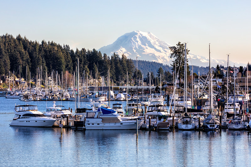 Marina in Gig Harbor with boats in the harbor with Mt Rainier