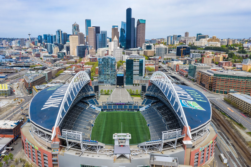 Centurylink field with the Seattle skyline in the background