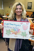 IMG_7794 Robin Fox holding up a sign made by school children that wishes the homeless a HAPPY THANKSGIVING - ENJOY YOUR MEAL