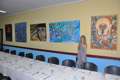 Alex Eisman, New York artist and student poses with her paintings on exhibit at El Patronato Synagogue in Havana, Cuba, March 22, 2013.  PHOTO BY: Cynthia Carris Alonso http://www.photosolutionsnyc.com/