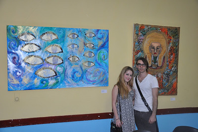 Cuban artist and exhibit curator, Lancelot Alonso, stands with Alex Eisman, Jewish New York artist, in front of her paintings on exhibit at El Patronato Synagogue in Havana, Cuba, March 22, 2013.   PHOTO BY: Cynthia Carris Alonso http://www.photosolutionsnyc.com/