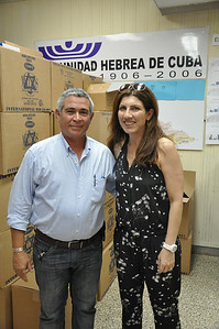 Valerie Feigen, mother of exhibiting artist, Alex Eisman, stands with David Prinstein, Vice-President of El Patronato Synagogue, in Havana, Cuba, March 23, 2013, in front of boxes of food donated from Canadian Jews for Passover.  PHOTO BY: Cynthia Carris Alonso http://www.photosolutionsnyc.com/