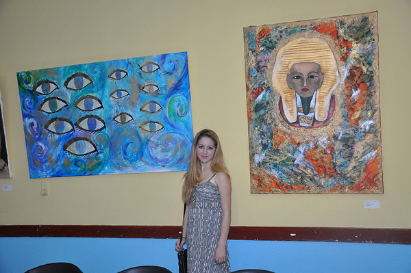 Alex Eisman, Jewish New York artist, stands with her paintings on exhibit at El Patronato Synagogue in Havana, Cuba, March 22, 2013. 