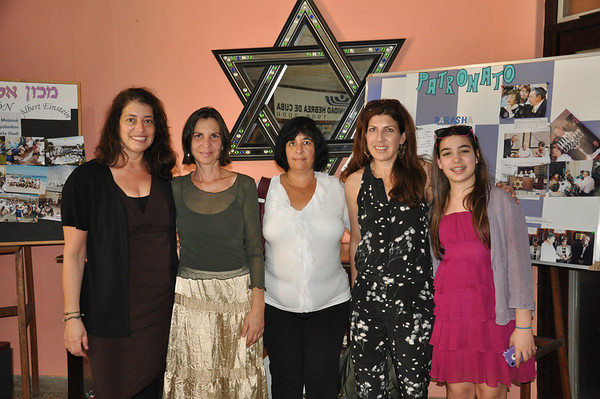 L-R: Cynthia Carris Alonso, translator and photographer, Rayda Rodriguez, exhibit coordinator, Digna Alonso, guest, Valerie Feigen, mother of exhibiting artist, and Alicia Alonso, guest, pose at the art opening at El Patronato Synagogue in Havana, Cuba, March 23, 2013.