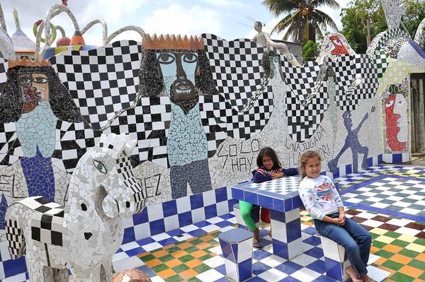 Neighborhood children play at the entrance to José Fuster's self-designed tiled house in Jaiminita, Cuba.