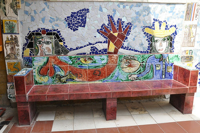 Bench seating area in the outdoor garden of Cuban artist, José Fuster's self designed tiled house in Jaiminita, Cuba.