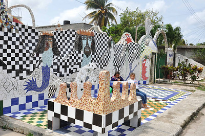 Neighborhood children play at the entrance to José Fuster's self-designed tiled house in Jaiminita, Cuba.